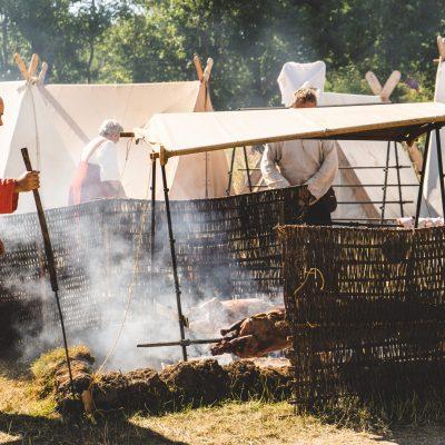 Man roasting a pig outside